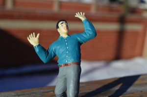 male action figure in a panic