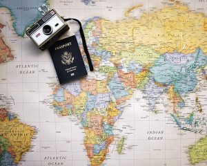 map, passport, camera