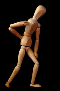wooden figure with back pain